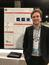 Richard Feder stands in front of this poster at 2018 AAS Meeting