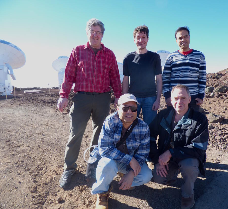 SMA team standing in front of the telescope
