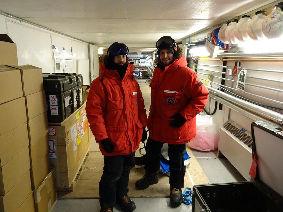 SPT winter-over scientists Andrew and Daniel getting ready to mount the EHT optics onto the South Pole Telescope.