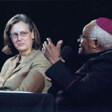 Image of Beth A. Simmons moderating Q&A with Desmond Tutu