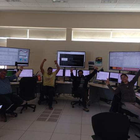 ALMA group celebrating in the control room