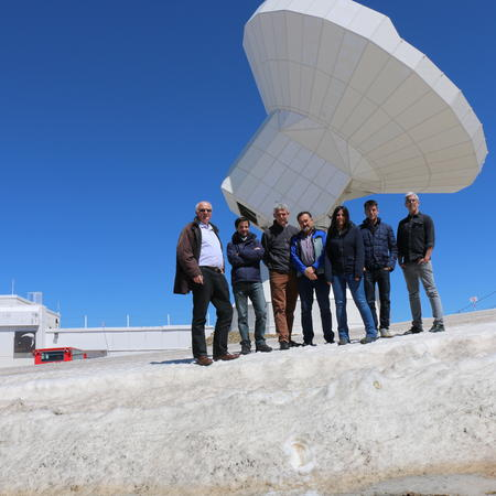 IRAM's Pico team outside with the telescope