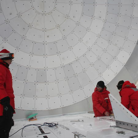 SPT scientists Dan, Wendy, Junhan, and Tom working on improvements to the EHT setup on the South Pole Telescope.