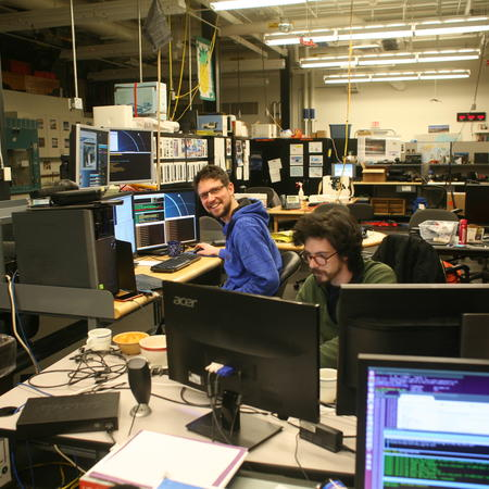 SPT winter-over scientists Daniel and Andrew in control of the South Pole Telescope during EHT observations.