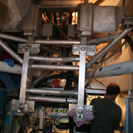 Dan working on the South Pole Telescope EHT electronics inside the telescope receiver cabin.