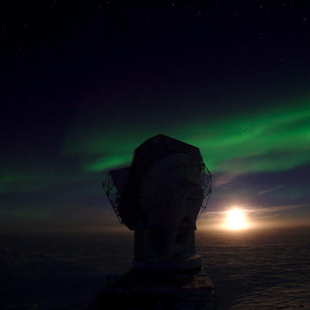 The South Pole telescope illuminated by the Full Moon and exceptionally bright aurora australis.