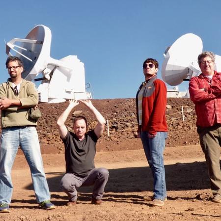 VLBI Team at SMA standing in front of telescope