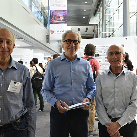 Mark Fishman, Doug Melton, and Lee Rubin at a poster session