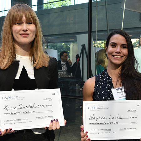 Karin Gustaffson and Nayara Leite standing with their awards