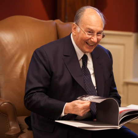 Image of His Highness the Aga Khan with photo album