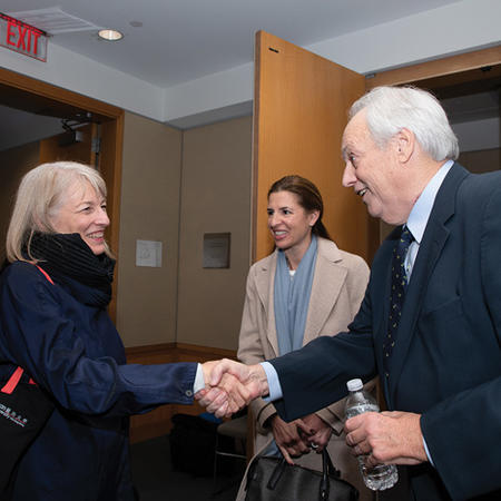 Image of Kathryn Sikkink shaking David Manshel's hand