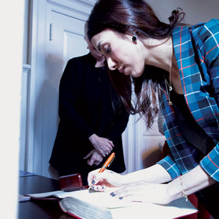 Image of Nadia Murad signing a book in the green room