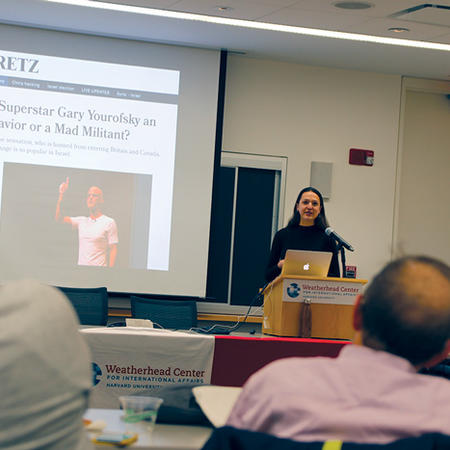 Image of Nina Gheihman speaking at the Weatherhead Forum