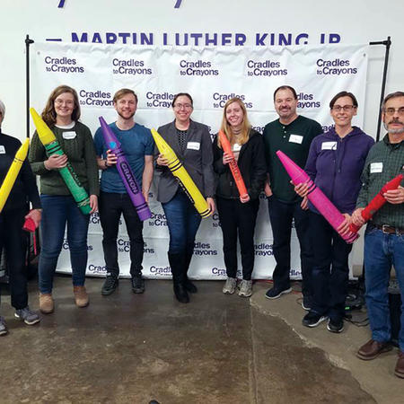 Image of WCFIA staff volunteering at Cradles to Crayons