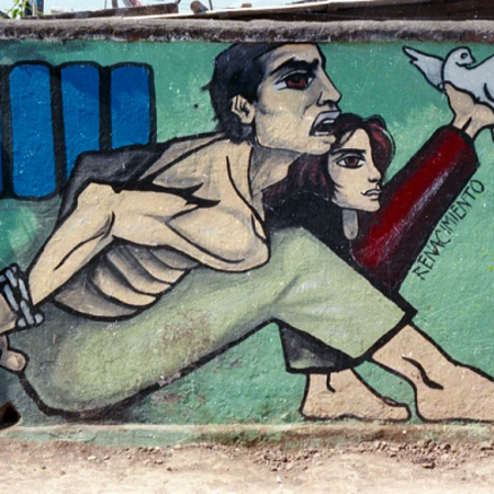 Mural depicting a man and woman in a prison cell.