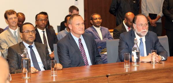 Three members of the US Embassy in Ethiopia, including Ricardo Hausmann, sitting at a table