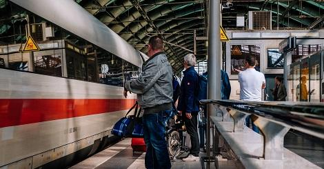 People standing by train in Berlin, Germany