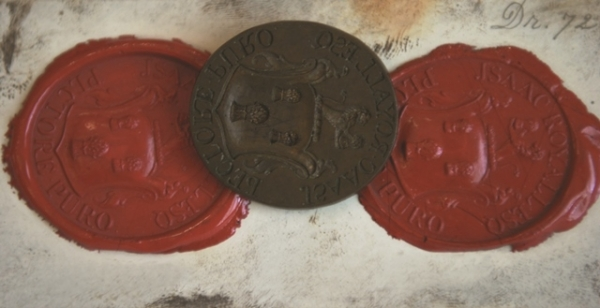Iron seal of Isaac Royall with two red wax impressions on either side