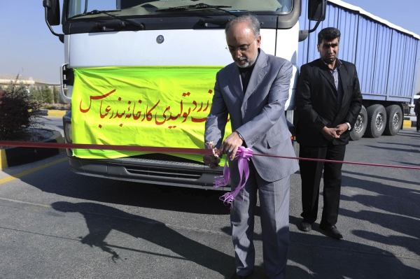 Ali Akbar Salehi, head of the Atomic Energy Organization of Iran, celebrates Iran's first domestically mined raw uranium