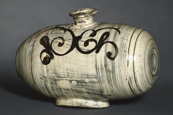 Drum-Shaped Bottle with Stylized Floral Decor