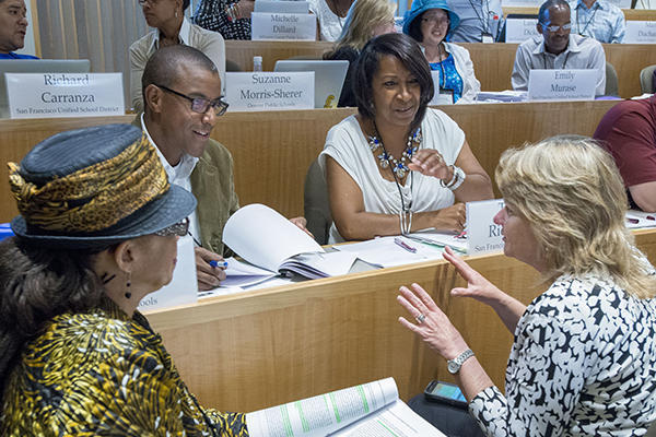 Participants engaged in discussion in a classroom