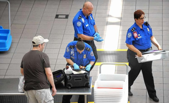 TSA officers inspecting luggage