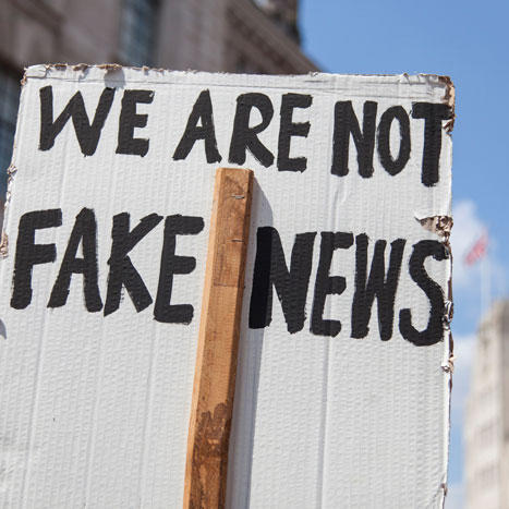Image of 'we are not fake news' sign at a protest