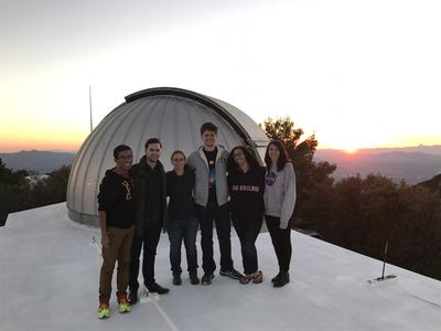 Undergrads on roof with telescope