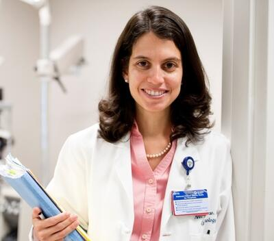 Dr. Lucia Sobrin in an exam room