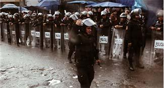 Police officers standing in the rain