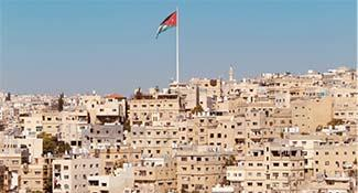 Aerial view of city in Jordan with flag