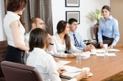 A team of people sitting at a conference table