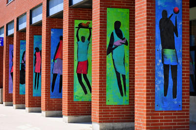 colorful mural of people on brick wall