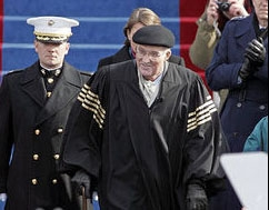 Chief Justice Rehnquist arrives at the inauguration of President George Bush showing his gold-striped sleeves