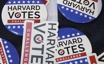 Buttons saying Harvard votes
