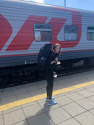 Image of Sierra Nota with her backpack on ready to board train