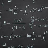 Calculus equations written in white on a black chalkboard
