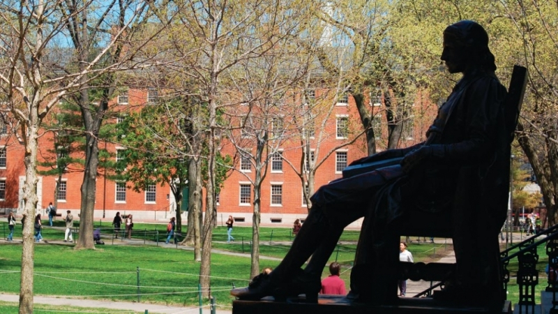 The John Harvard Statue overlooking the Yard.