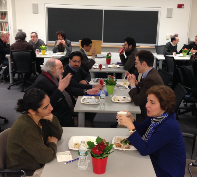 A photo of Shahab Ahmed (middle table) deep in discussion with his colleagues Dimitri Gutas and Khaled Al Rouayhebat, at a luncheon during the MS. Török workshop at Harvard, April 5, 2014.