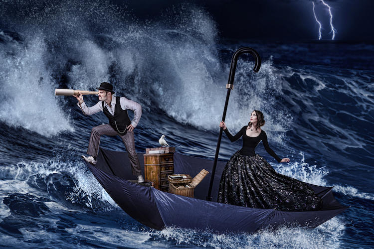 19th century man and woman in a boat on stormy seas