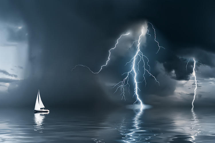 ship at sea at night in a storm