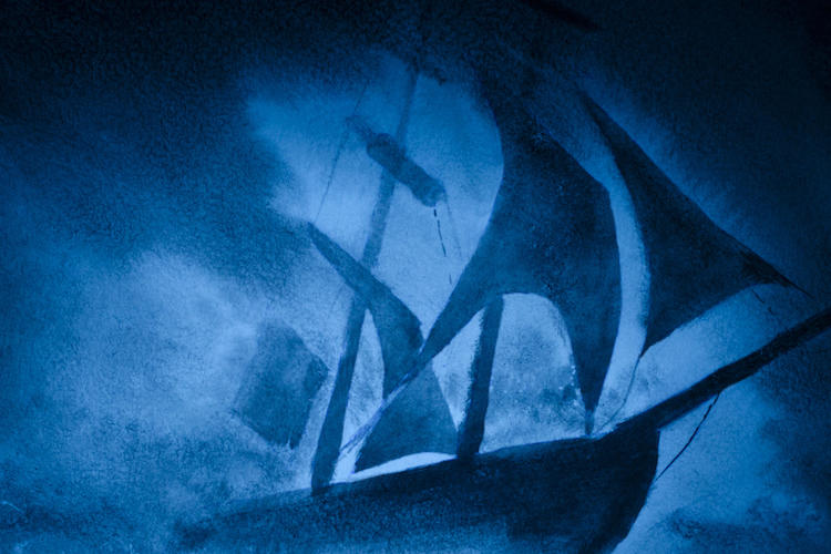 ship on stormy sea in shades of blue