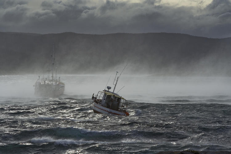 Two ships on a steamy, turbulent sea