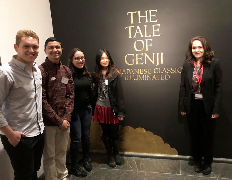 "On the left, four EAS concentrators stand in front of a museum exhibition sign reading ""The Tale of Genji: A Japanese Classic Illuminated,"" while on the right stands Professor Melissa McCormick."