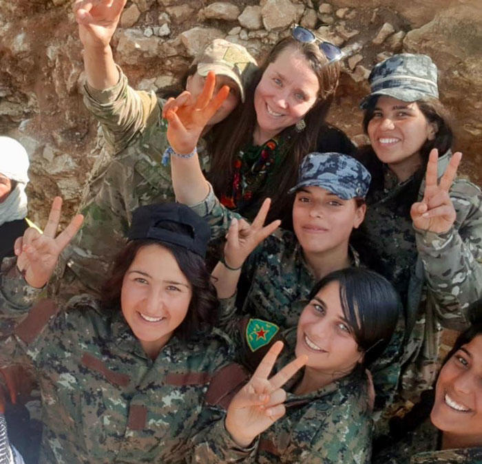 Holmes with members of the Syrian Democratic Forces