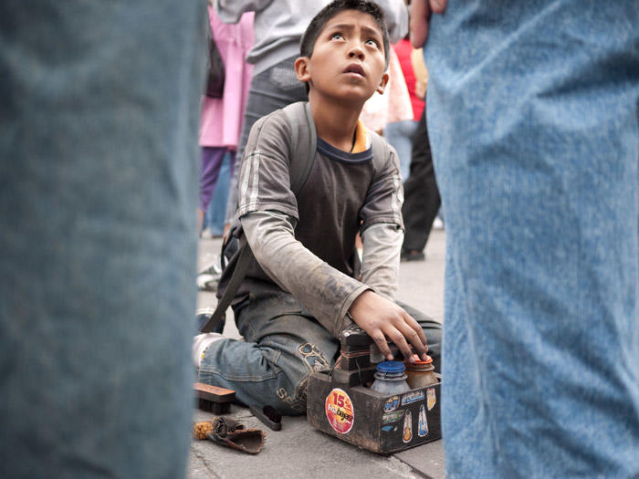 Image of young boy shining shoes
