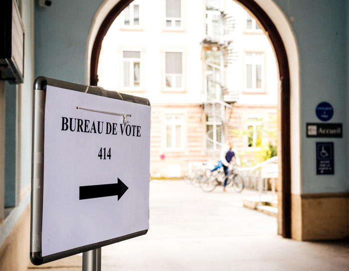 Image of voter registration sign in doorway