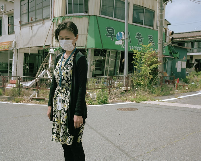 Image of woman in mask on street