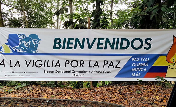 "Banner in rural Colombia that has a message in Spanish that translates to ""Welcome to the Vigil for Peace—Finally peace! No more War."""