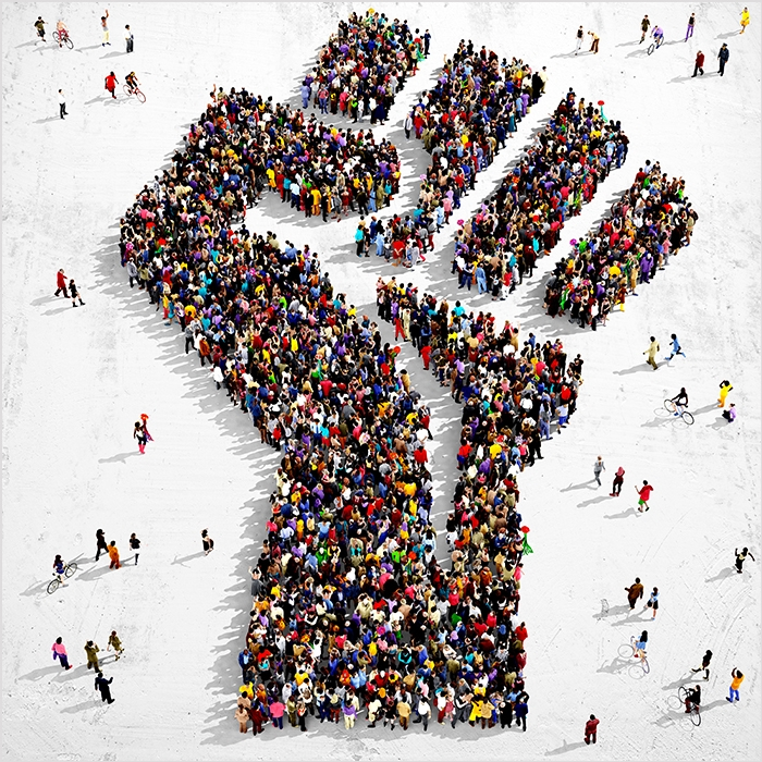 Image of raised fist made of people